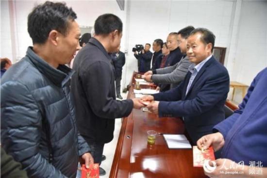 分红亚洲_湖北秭归峡口茶叶合作社144名社员喜分红