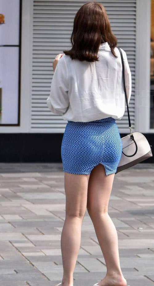 丰满小姐姐包臀裙裹出肥硕臀部,这样子看着是个生儿子