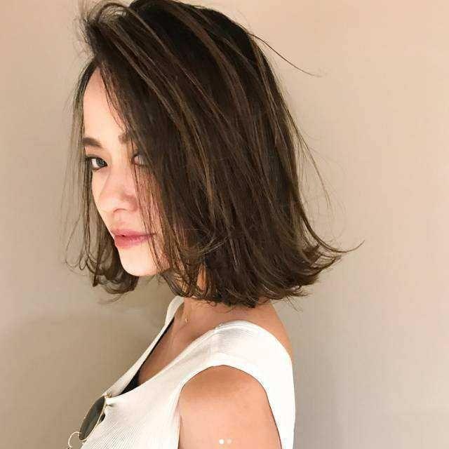 发尾外翘的齐肩发,不仅可以显得脸小,还能让发型更独特.图片